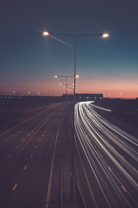 iphone long exposure photography on a road showing light trails