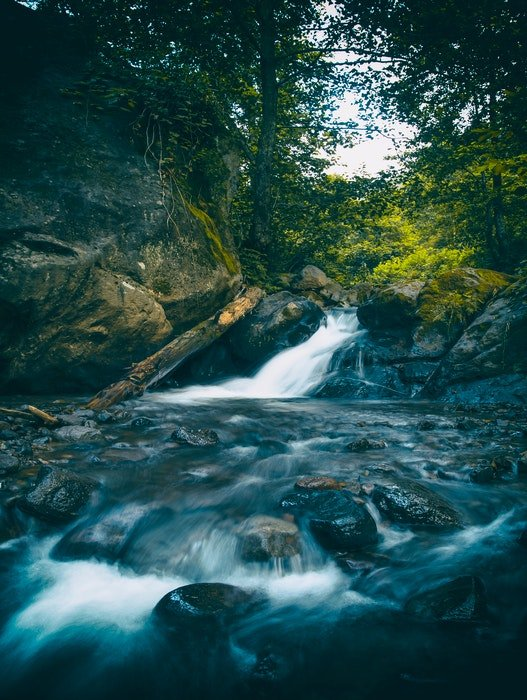 long exposure image of waterfall and rapids