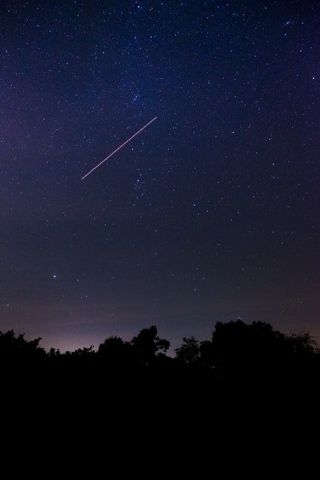 long exposure of a meteor shower at night