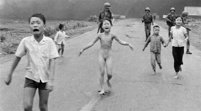 Nick Uts iconic image of the Vietnamese conflict, where we see a naked 9-year old girl running toward the camera