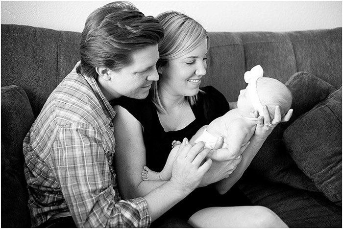 Black and white portraits of parents holding their newborn child