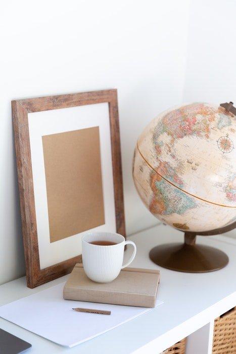 photo frame and globe on desk