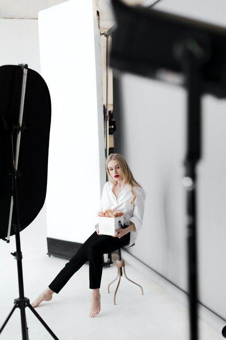 A blonde model posing for a portrait