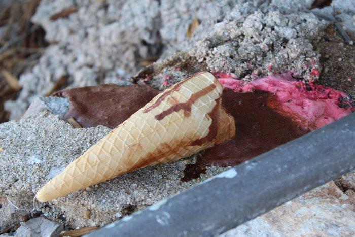 A fallen melting ice-cream cone