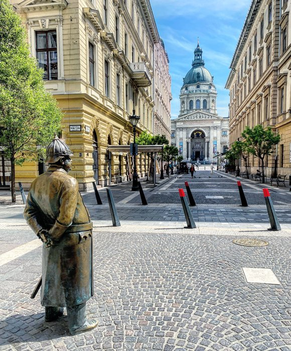 Bronze statue in a street in front of St Stephens Basilica in Budapest