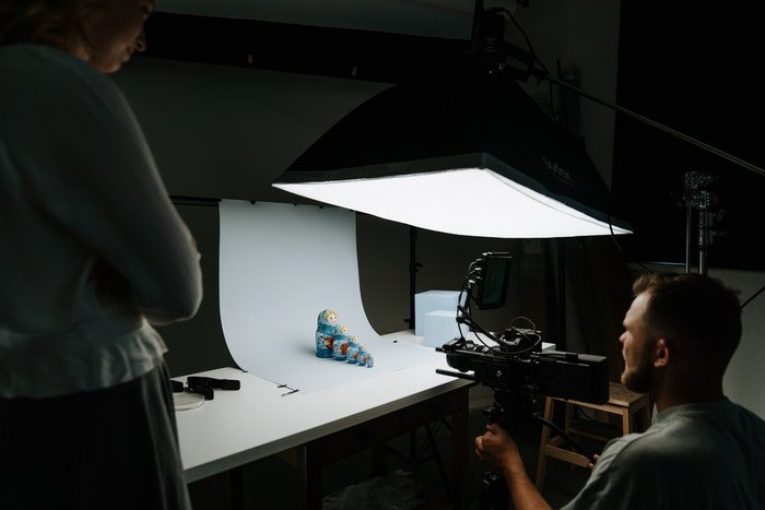A photographer shooting a toy photography shot in a studio
