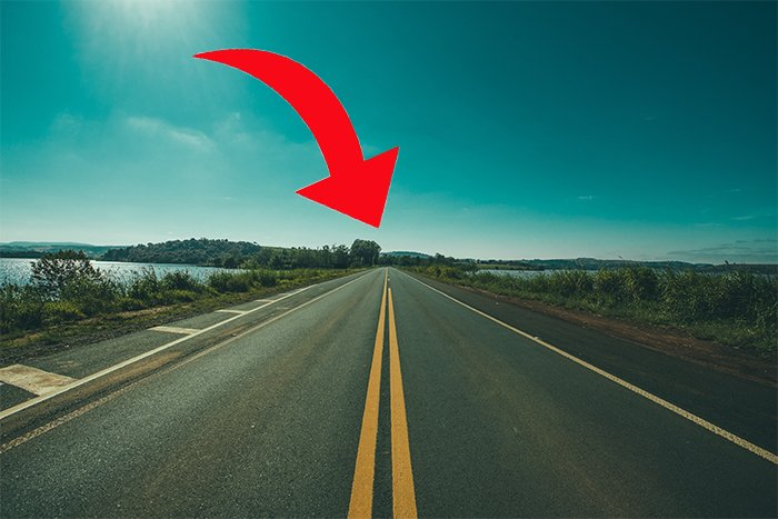 photo of an empty road with a red arrow showing vanishing point on the horizon line