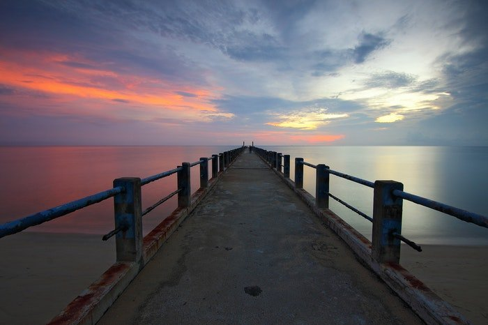A small pier at sunset demonstrating vanishing points in photography