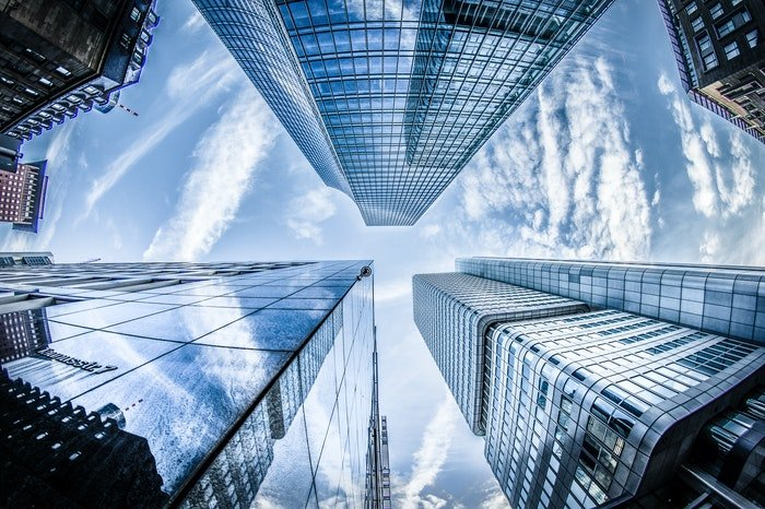 Low angle photo looking up at huge skyscrapers