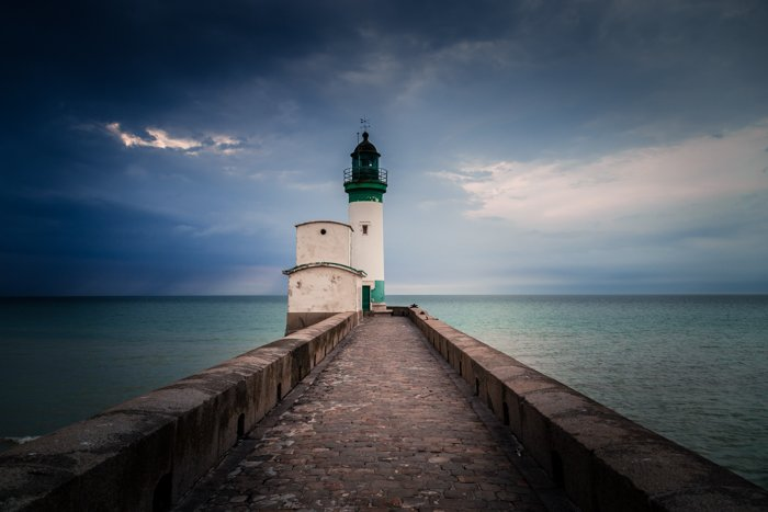lighthouse on a beach  with vignette around the edges of the photo