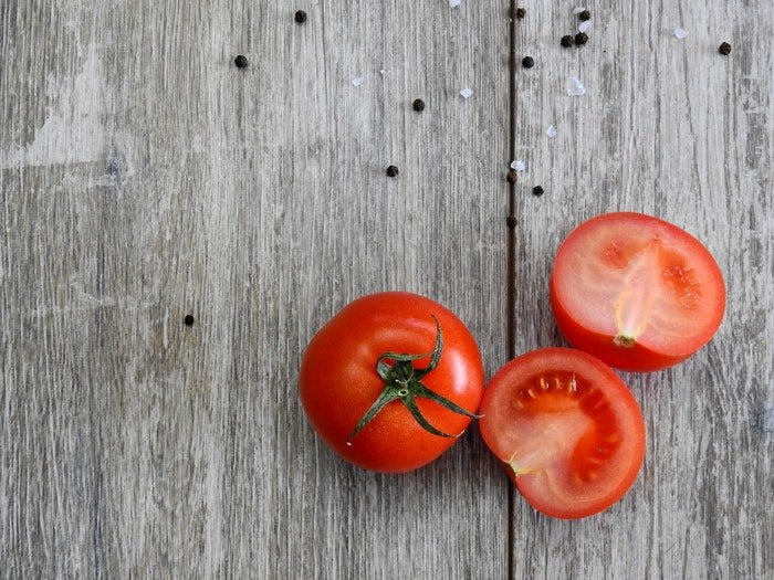 colour contrast between the tomatoes and wood help create a balance composition which draws attention