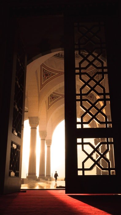 Image of interior architecture of large doors which are opened to create an interesting balance in the image