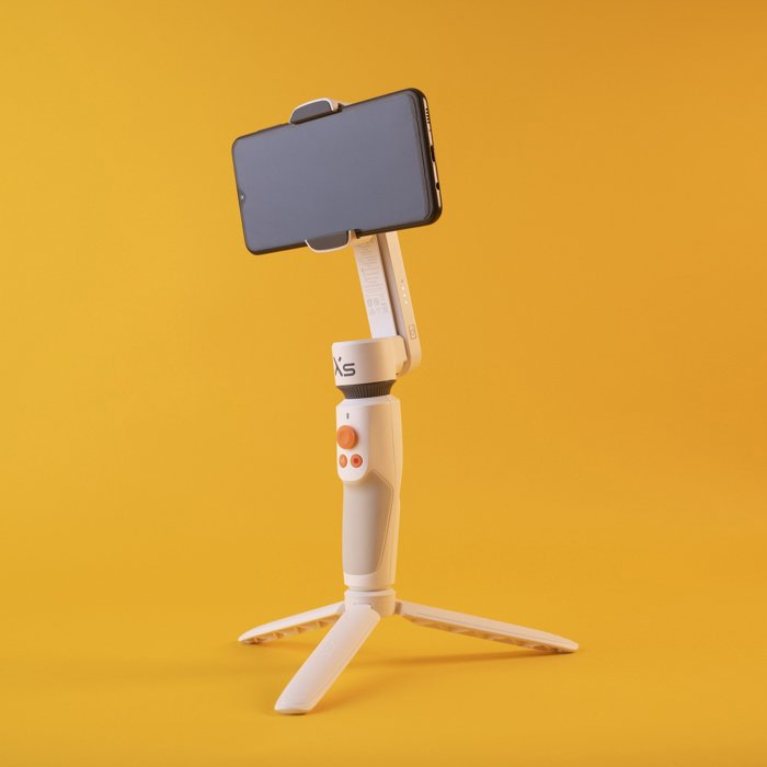 An iphone on a Zhiyun Smooth XS gimbal