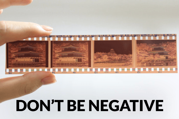 Photographer joke over a photo of a person holding a roll of negative