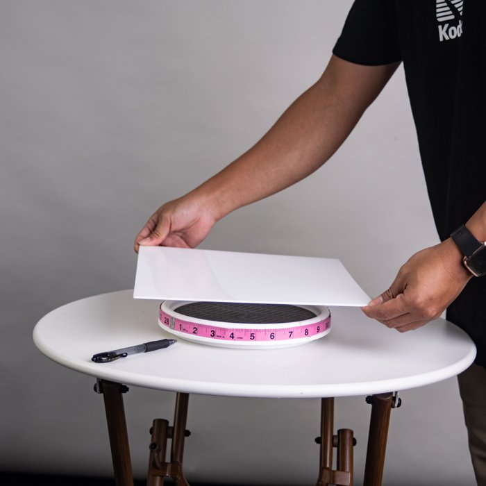 A man makingr a DIY Turntable for 360 product photos