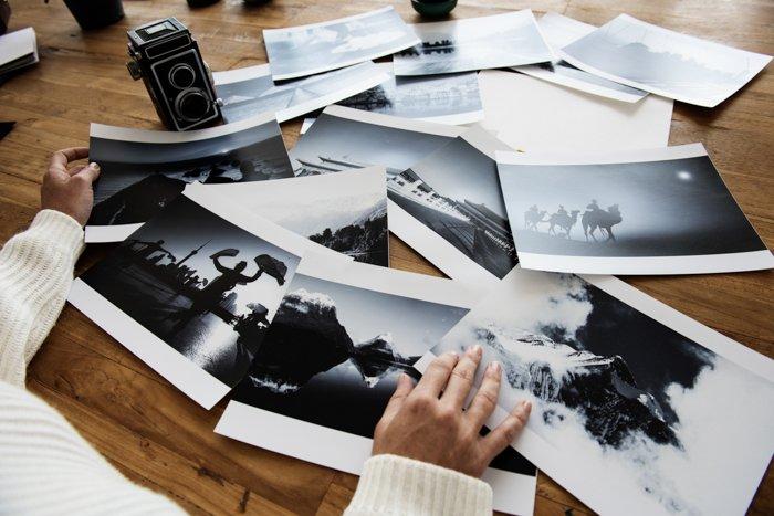 A person looking at printed photos