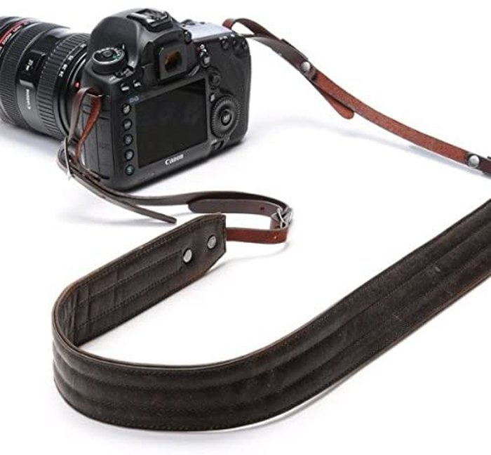 DSLR camera with a leather neck strap