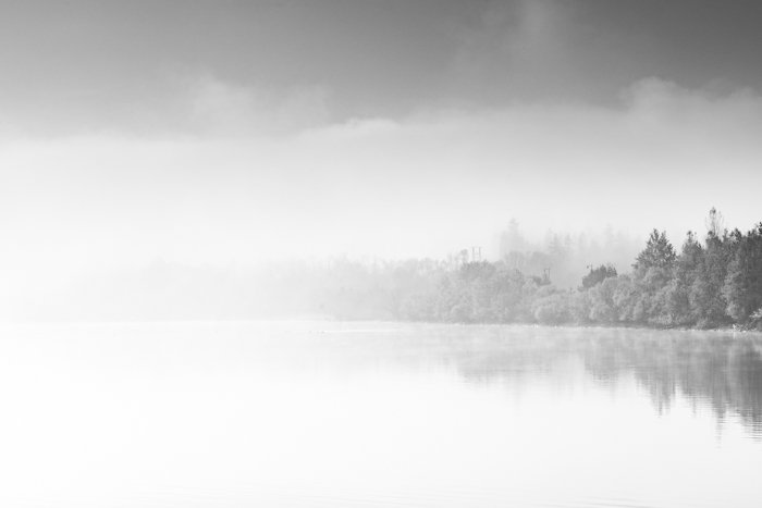 Abstract contemporary art, fog over lake in black and white