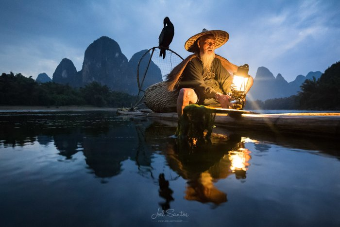 An Asian fisherman and a cormorant