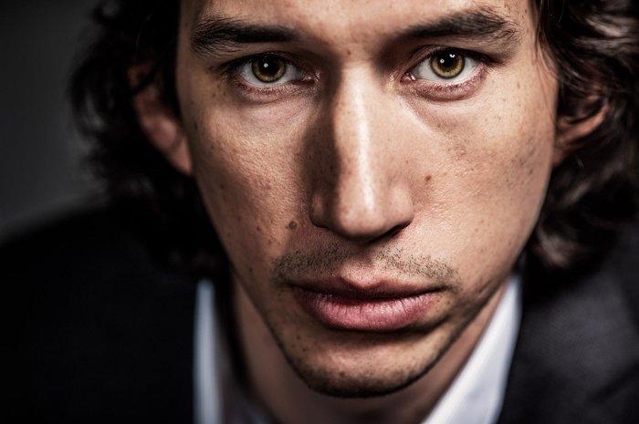A closeup of a man, staring at the camera