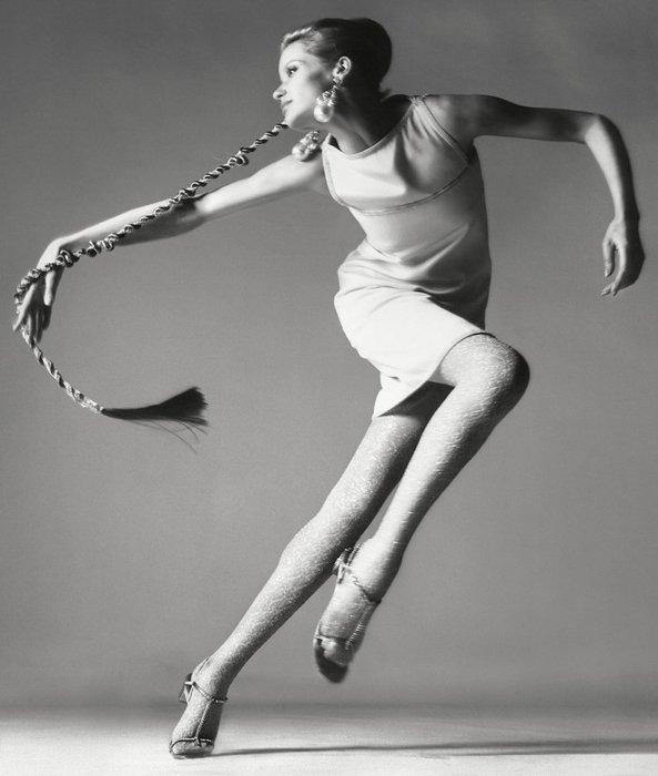 Woman dancing, she has long hair