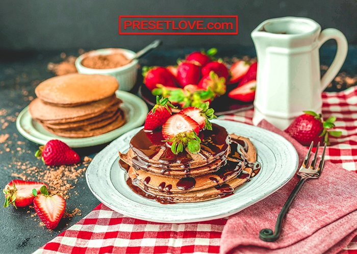 Image of pancakes with strawberries and syrup edited with PresetLove free lightroom Presets
