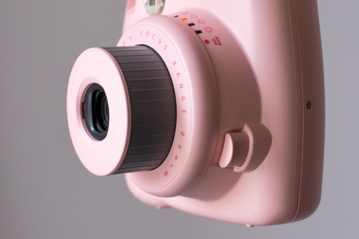an image of the the lens from a pink fujifilm instax mini 8