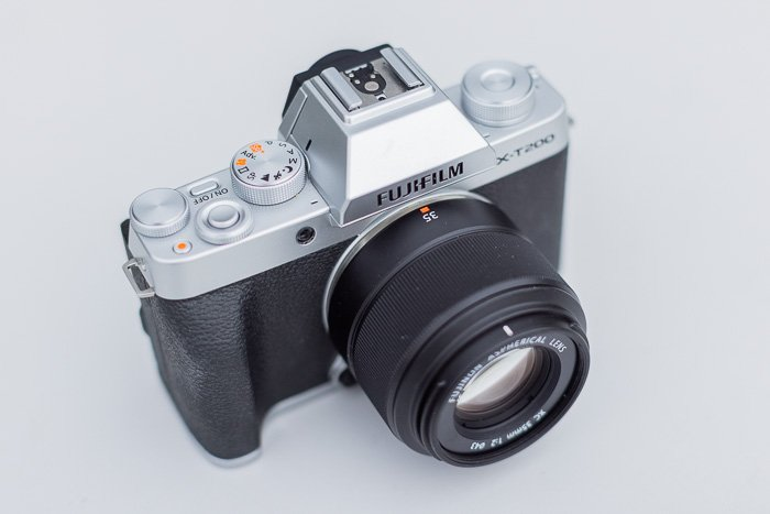 Image of the Fujifilm XC 35mm f/2 lens attached on the Fujifilm X-T200