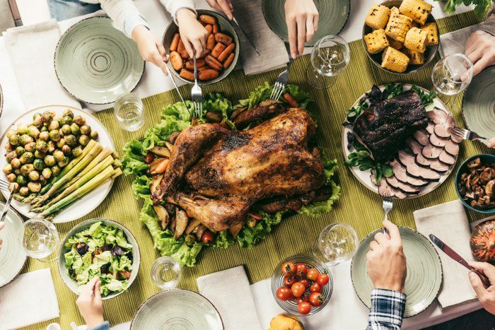 Autumn photography of a Thanksgiving turkey and side dishes on a table