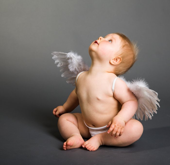 Sweet Christmas photo of a baby dressed up in angel wings