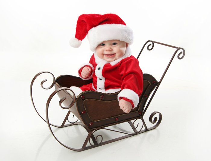 Sweet Christmas photo of a baby dressed as Santa Claus