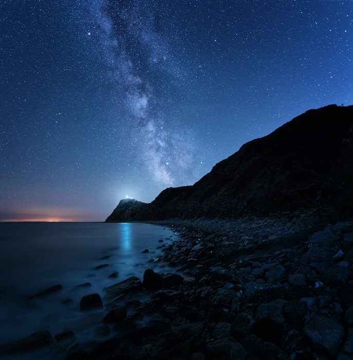 an hdr image of Cape Emine at night with the beach and milky way