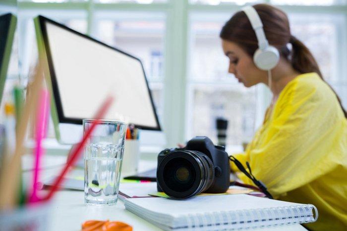 A girl editing photos at a desk