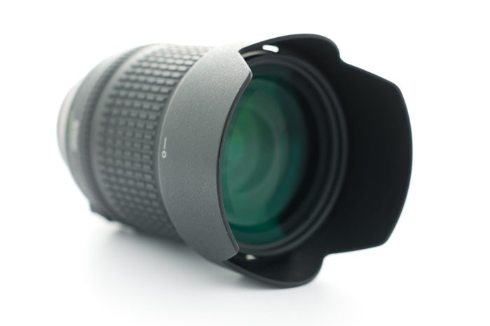 an image of a camera lens with hood