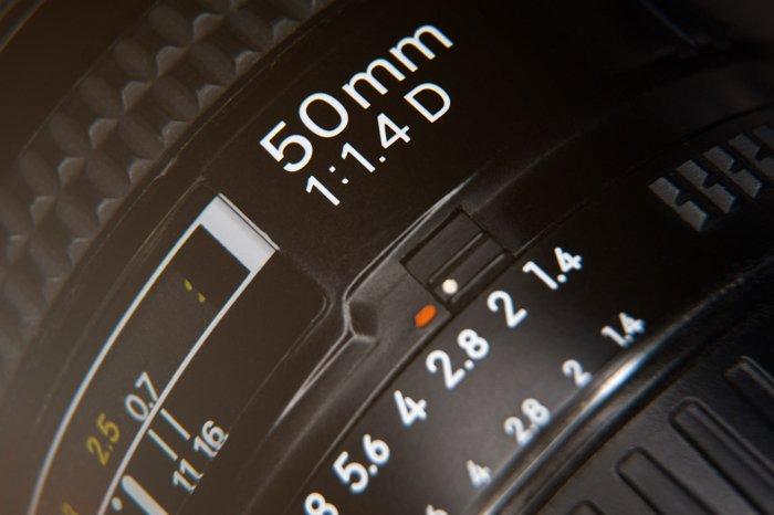 an closeup image of a 50mm camera lens focus ring