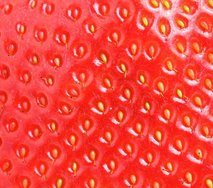 a macro image of a strawberry