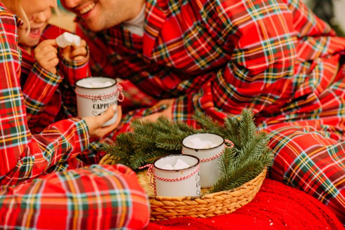 christmas card photo ideas of a close up portrait of a family in matching pyjamas