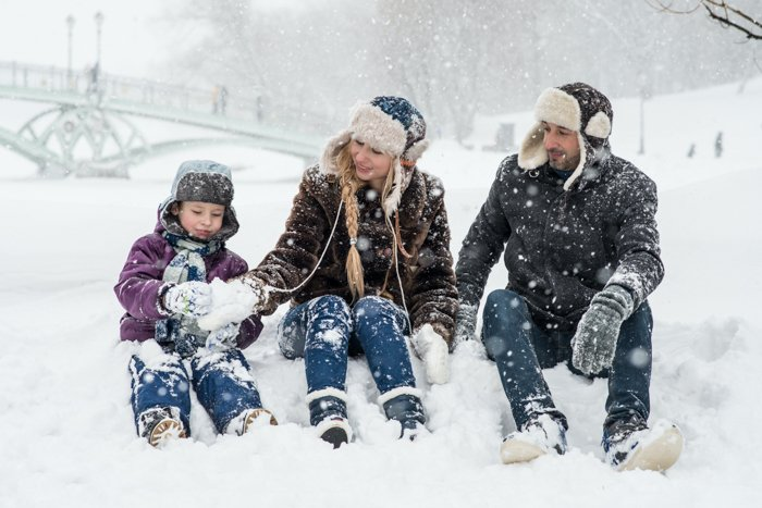 Personalized family Christmas card photo idea of a family of three in the snow
