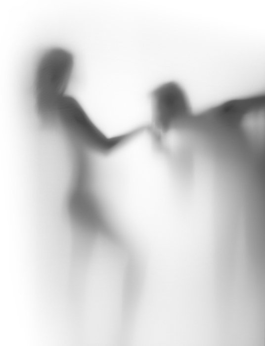 An artistic engagement photography black and white silhouette of a man kissing the hand of a woman