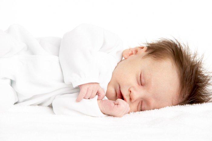 Baby Sleeping on side on blanket