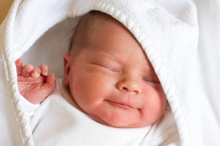 newborn baby in a white blanket