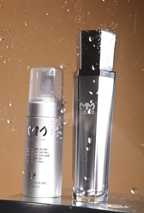 Product photography image of two cosmetic items with water droplets