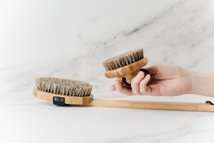 Product photography image of brushes with a model's hand