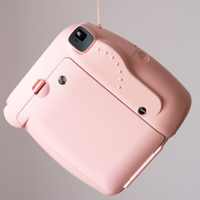 an image of the back of a pink fujifilmn instax mini 8 instant camera