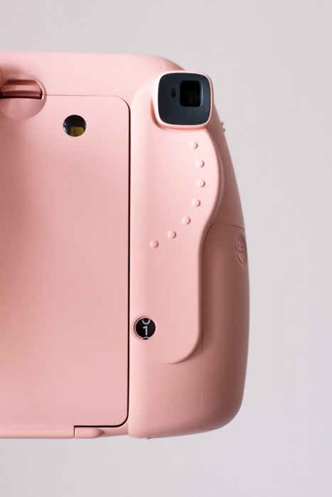 an image of the back and viewfinder of a pink fujifilm instax mini 8 camera