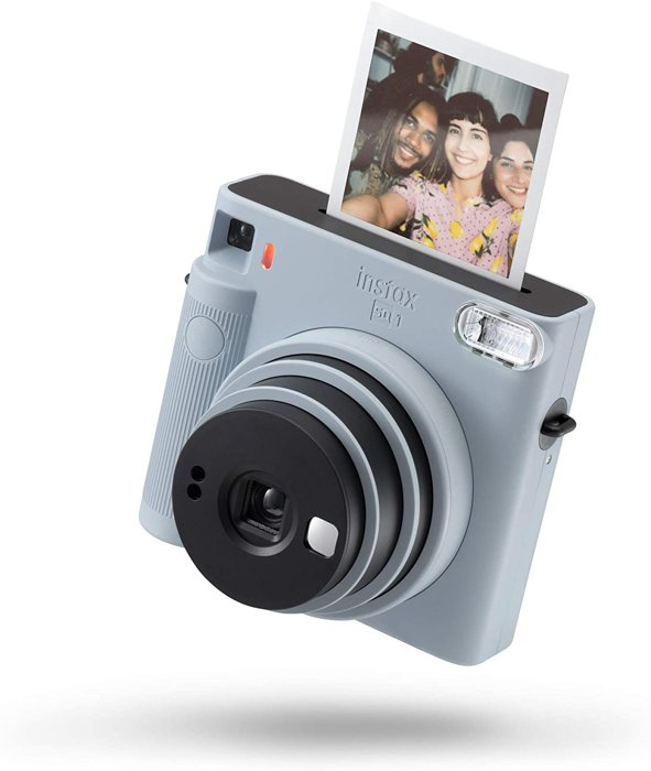 an image of a grey Instax mini 8 instant film camera with an instant photo coming out of the top