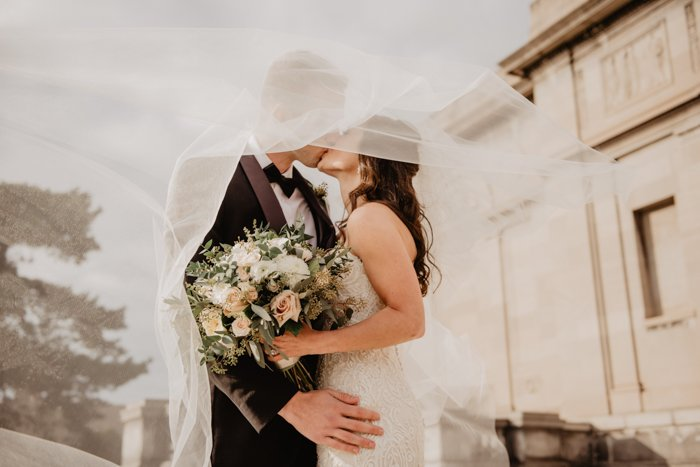 Stunning wedding portrait of the couple kissing