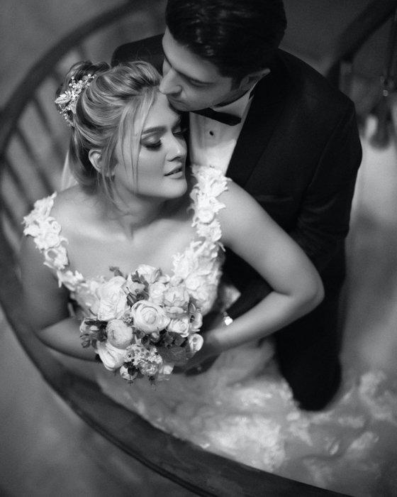 Greyscale wedding portrait of the happy couple