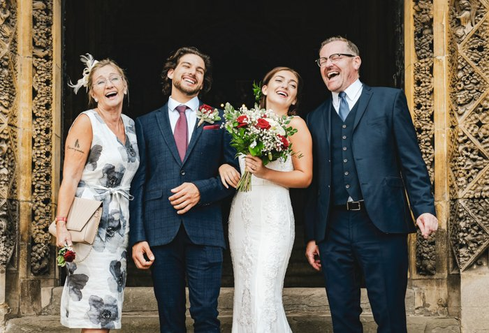 an image of a bride, groom and family members celebrating their wedding