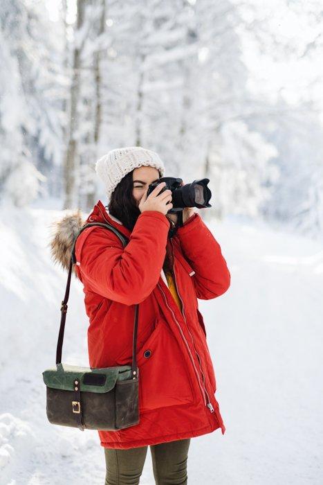 A photographer shooting winter photos outdoors